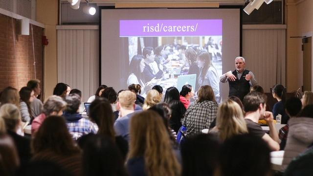 Kevin giving presentation at a career workshop to a room of people