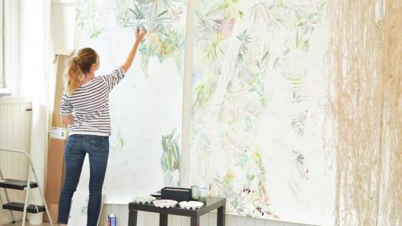 artist painting on large canvas
